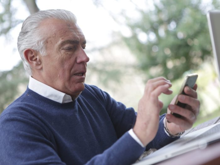 older adult with smartphone