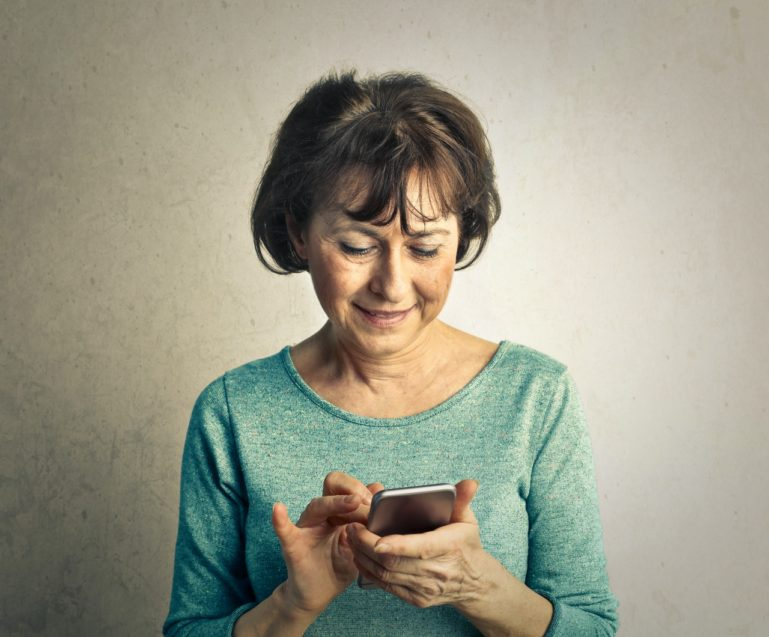older adult using smartphone