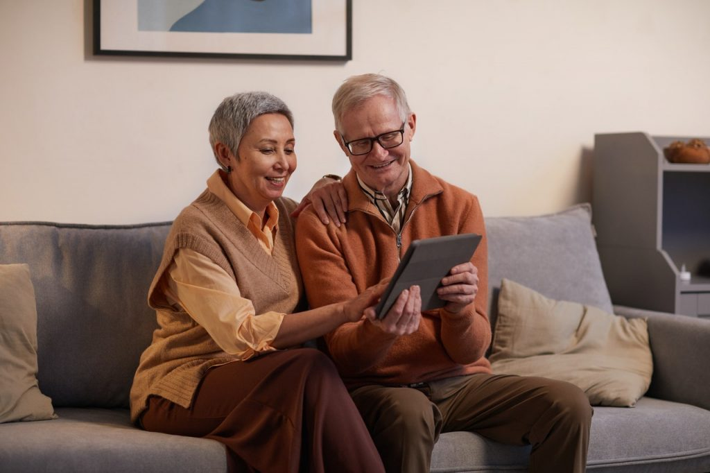 woman and man using tablet
